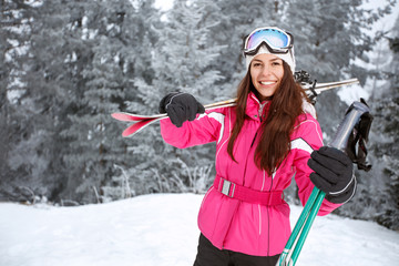 Female skiers with skis in mountain
