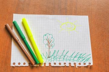 Children's picture with felt-tip pens, the sun. Three felt-tip pen