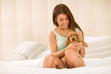 Cute girl hold very sweet puppy pet