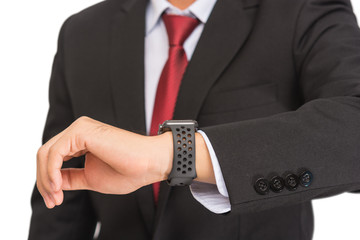 Close up of a man in black suit see at watch on his hand with white background