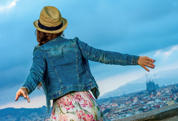 traveller woman in front of cityscape of Barcelona relaxing