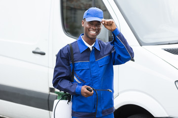 Young Smiling Male Worker With Pesticide Sprayer