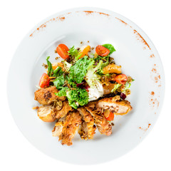 Delicious juicy roasted meat with spices and parsley in a white plate on light background. Top view, flat lay