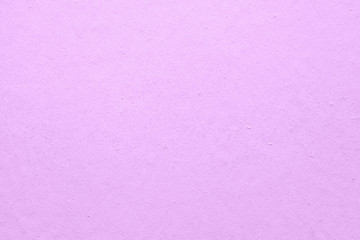 Wall painted in pink color texture background.