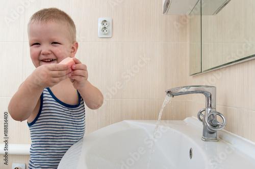 Happy Boy Taking Bath In Kitchen Sink Child Playing With