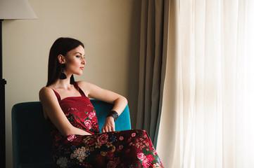 Beautiful woman near a window
