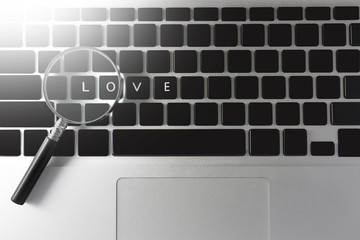 Magnifier and notebook, with the word I love you and have the light in and on Valentine's Day.