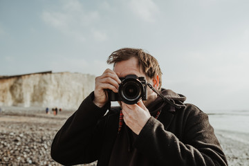 Male photographer taking picture of the landscapes with dslr