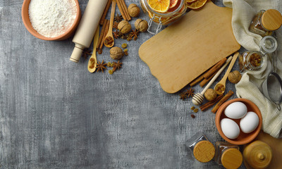 Natural organic products and spices for cooking food and baking on a wooden background. Kitchen background. Composition in a rural style. Top view.