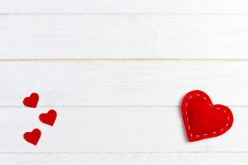 Hearts on white wood background. Valentines day background