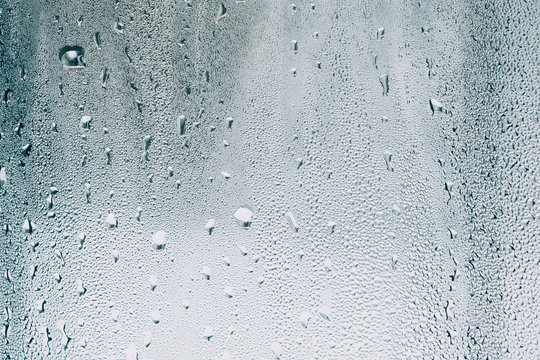 water drops on glass, window with condensation, close-up