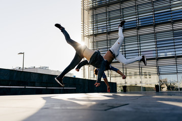 Men performing trick on street