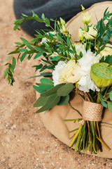 Wedding bouquet lay in the sand