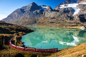 train in the scenic swiss alps around bernina and moteratsch glacier Wall mural