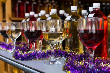 glasses of white wine and red wine bottle background on the table
