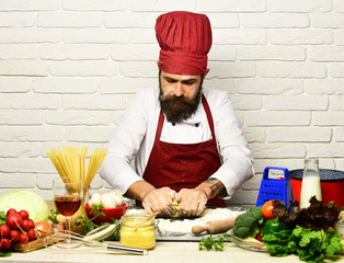 Cooking process concept. Chef makes dough. Man with beard
