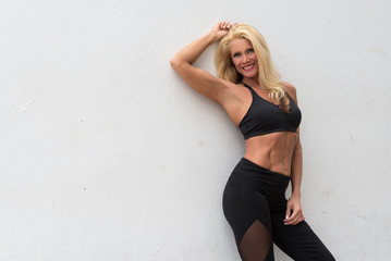 Fitness Model Against a White Wall