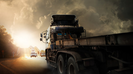 Truck with storm clouds,transportation during bad weather condition concept. Wall mural