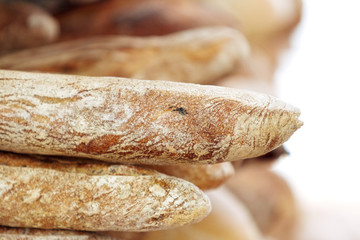 Close-up of baguettes stacked with sunlight