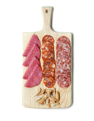 Assorted Iberian pork cured sausages on cutting board isolated on white background. Top view