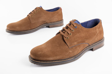 Male brown leather shoe on white background, isolated product, comfortable footwear.