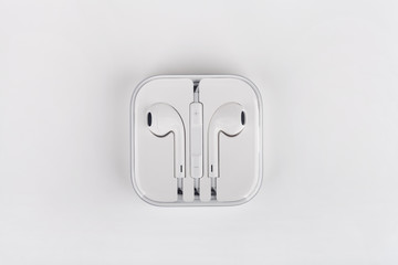 White headphones for smartphone in transparent box