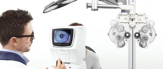 optometrist examining eyesight  patient in optician office