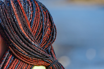 Close-up of woman afro braids and dreadlocks, outdoor shot