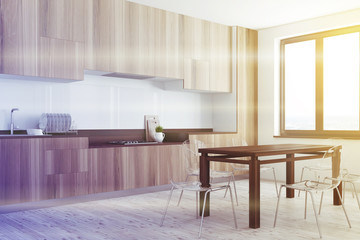White, wooden dining room and kitchen corner toned