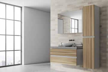 White and wooden bathroom corner