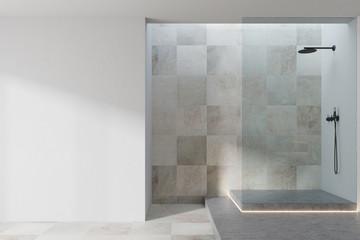 White and tiled bathroom interior, shower