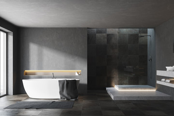 Black and tiled bathroom interior