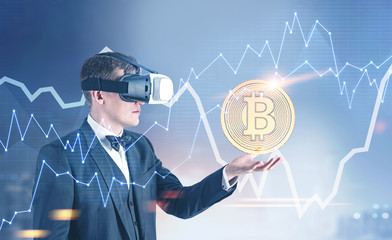Businessman in VR glasses showing a bitcoin