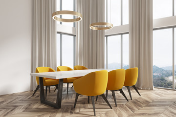 White dining room corner, yellow chairs