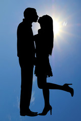 silhouette of a kissing couple