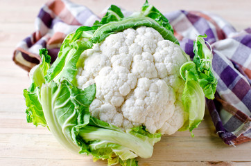 Fresh cauliflower on a wooden table