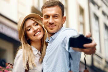 Romantic Couple In Love Taking Photos On Street.