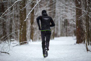 Photo from back of athlete on run in winter