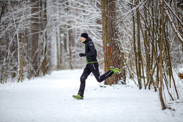 Photo from side of athlete on run in winter