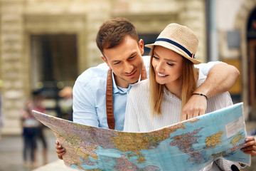 Travel. Tourist Couple With Map On Street