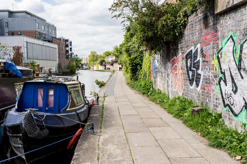 London, UK - April 2017. Narrowboats on the canalside towpath near Camden Town, , London, England, UK