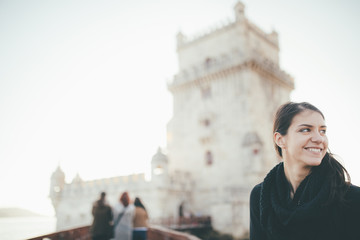 Beautiful traveler woman tourist fascinated by the Belem Tower.Tower of St Vincent in Lisbon,Portugal.Amazing european destinations.Travel and leisure concept