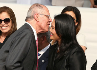 Peru's President Kuczynski greets Keiko Fujimori as they wait along with others for Pope Francis to arrive, in Lima