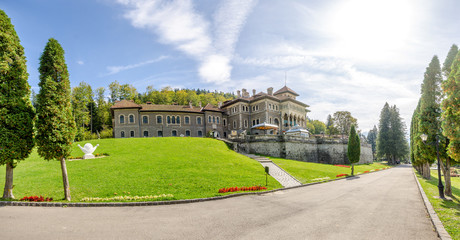 Cantacuzino Castle in a panoramic wide view on a sunny summer day with this beautiful neo romanian national monument landmark