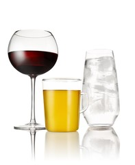 Three drink glasses, red wine, beer and water on white background
