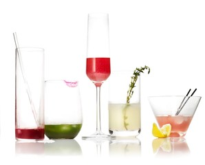 Empty cocktail glasses on white background