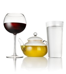 Red wine, tea in glass teapot and water on white background