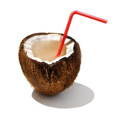 Coconut with drinking straw on white background