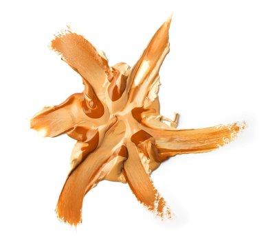 Smeared beige liquid cosmetics