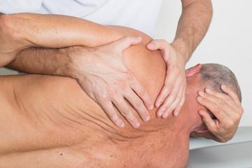 Massage therapist giving a back massage
